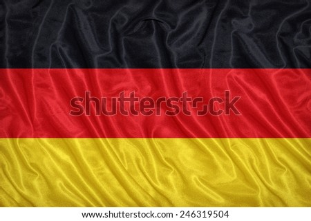 Germany flag pattern on the fabric texture ,vintage style - stock photo
