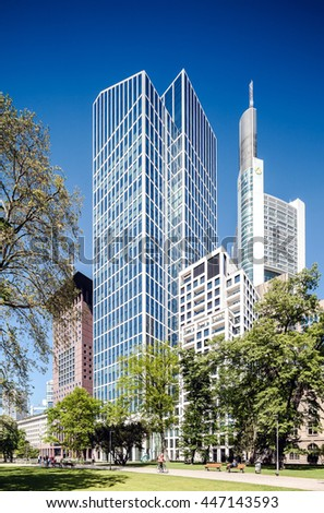 GERMANY, FRANKFURT MAIN - JUNE 22, 2016: TaunusTurm office and apartment skyscraper in green park of Frankfurt am Main