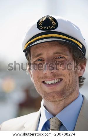 Germany Hamburg portrait of man with sailor cap smiling - stock photo
