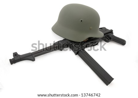 Germany in the Second World War. Composition with the most widespread battle helmet (M35) and  submashine gun MP40 - stock photo