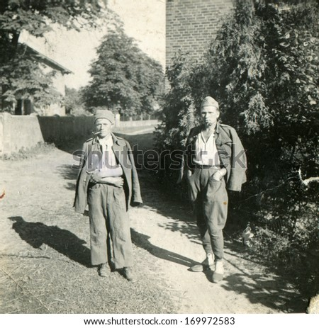 GERMANY, January 15, 1941: Vintage portrait of two Polish prisoners of war