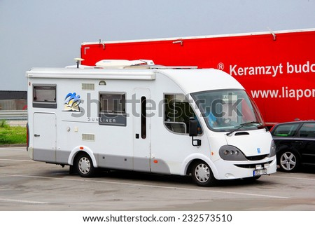GERMANY - JULY 21, 2014: White campervan Knaus Sun Liner at the interurban road.