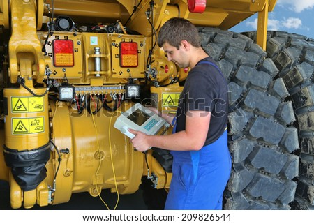 Germany Kaufbeuren circa July 2014: Service Mechanic in the review of a dump truck