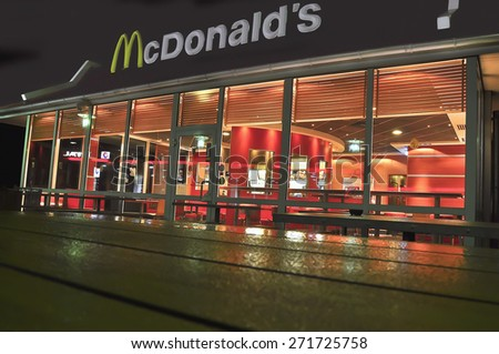 GERMANY_MARCH 18:McDonalds restaurant at night on March 18, 2015 in Germany.McDonald's is the main fast-food restaurant.  - stock photo