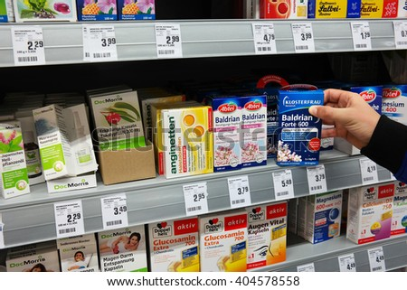 GERMANY - MARCH 2, 2016: Shelves with herbal medicinal products, medicines sold directly to a consumer without a prescription in a REWE supermarket. Photo taken on March 2, 2016 in Meppen, Germany - stock photo