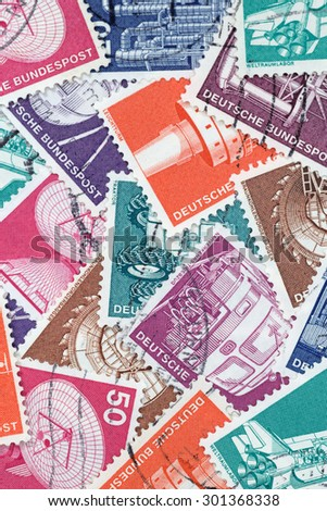 GERMANY - MAY 15, 1975: Macro photo of old German stamps about Industry and Technics - stock photo