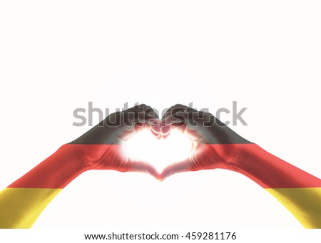 Germany national flag on people heart shape hands.