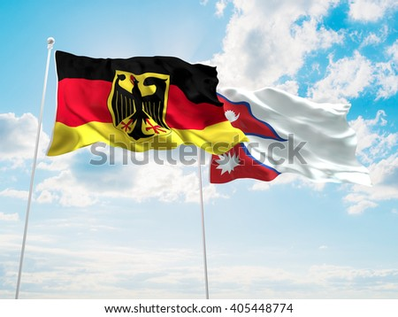 Germany & Nepal Flags are waving in the sky - stock photo