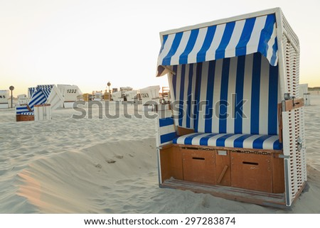 Germany, North Sea, beach chairs at beach - stock photo