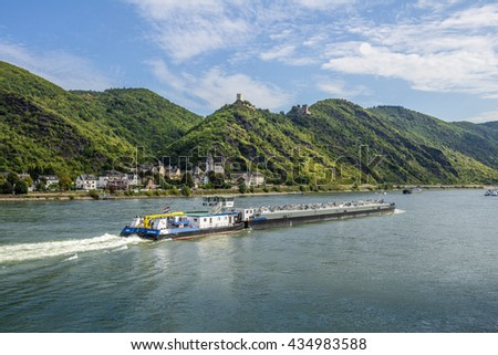 GERMANY; RHINE VALLEY, 2013-09-29: Dutch push boat passing the castles Sterrenberg and Liebenstein above Kamp-Bornhofen in the romantic Middle Rhine Valley