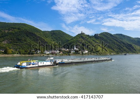 GERMANY, , RHINELAND PALATINATE, RHINE VALLEY, 2013-09-29: Dutch push boat passing the village of Kamp-Bornofen with the castles Liebenstein and Sterrenburg on Rhine River