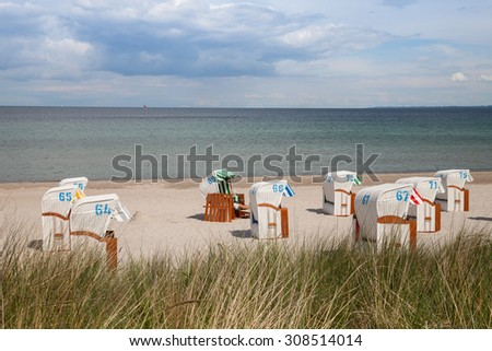 Germany, Schleswig-Holstein, Baltic Sea, beach chairs at beach - stock photo