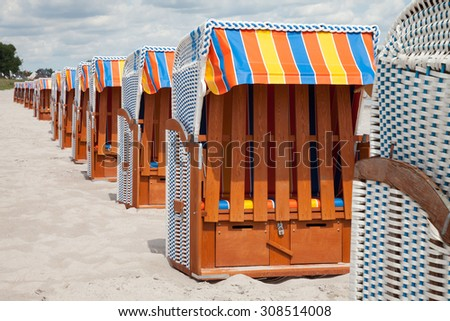 Germany, Schleswig-Holstein, Baltic Sea, closed beach chairs at beach - stock photo