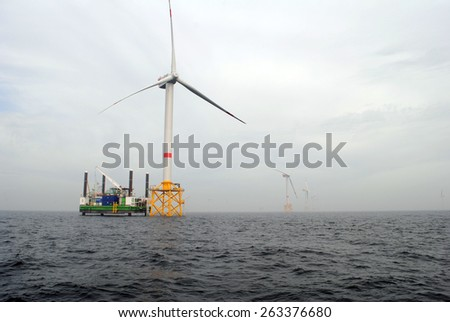 Germany Schleswig Holstein - July 13, 2014: Wind energy company repower is building a wind farm in Schleswig Holstein - North Sea - stock photo