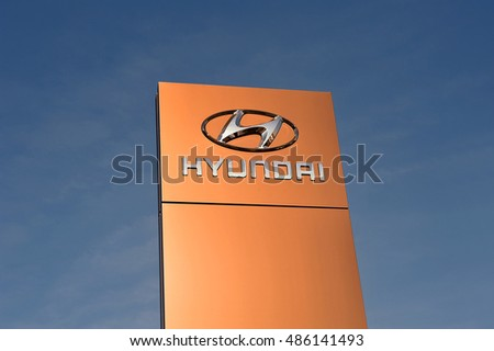 GERMANY-SEPT 15: HYUNDAI logo in the blue sky on September 15,2016 in ,Germany.Hyundai is a South Korean multinational automotive manufacturer headquartered in Seoul, South Korea.