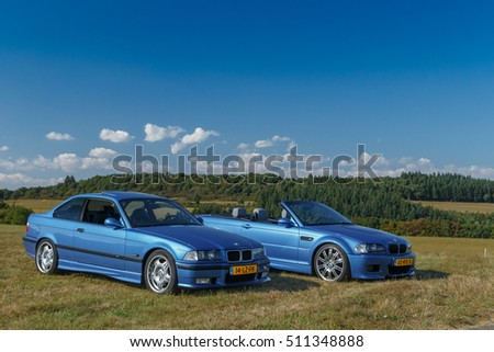 Germany, 26 September  2016, two BMW M3 cars in a landscap setting.