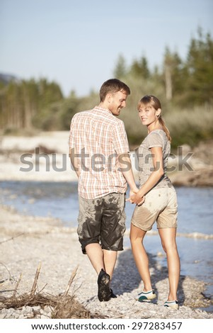 Germany,Upper Bavaria,Couple holding hands and walking