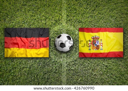 Germany vs. Spain flags on a green soccer field