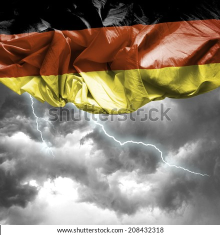 Germany waving flag on a bad day - stock photo