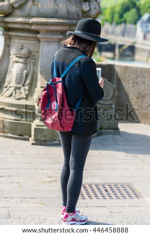 GERMANY, WURZBURG - MAY 22: Woman is taking pictures on the bridge in Wurzburg on May 22, 2015