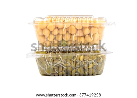 Germinated chickpea and lentil in a transparent plastic boxes isolated on white background - stock photo