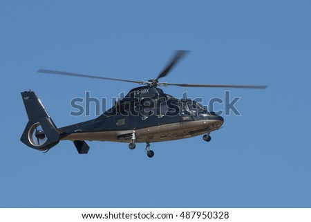 GERMISTON, SOUTH AFRICA-AUGUST 21 2016: A Dauphin business helicopter flies past with wheels extended at the Rand Airshow at Rand Airport.