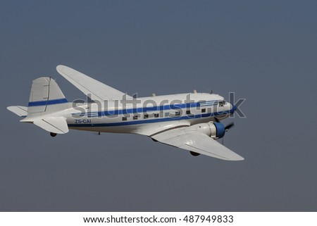 GERMISTON, SOUTH AFRICA-AUGUST 21 2016: A slow flypast of a vintage Douglas Dakota seen at the Rand Airshow at Rand Airport.