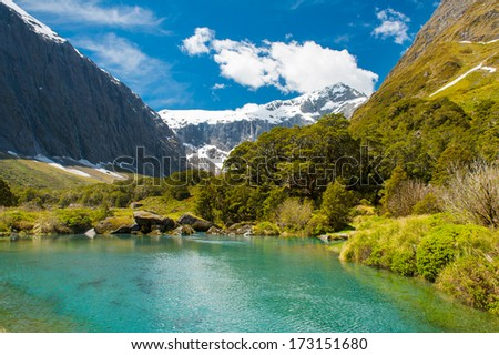 Gertrude Saddle with a snowy mountains and a turquoise lake, Fiordland national park, New Zealand South island
