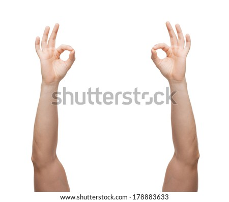 gesture and body parts concept - man hands showing ok sign