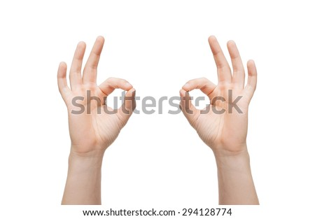gesture and body parts concept - man hands showing ok sign - stock photo