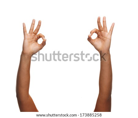 gesture and body parts concept - woman hands showing ok sign - stock photo