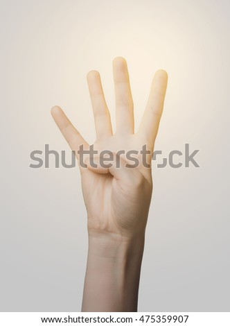gesture, count and body parts concept - close up of hand showing four fingers