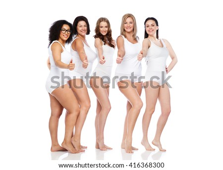 gesture, friendship, beauty, body positive and people concept - group of happy different women in white underwear showing thumbs up - stock photo