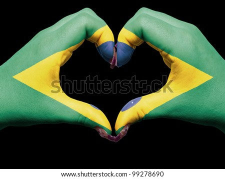 Gesture made by brazil flag colored hands showing symbol of heart and love