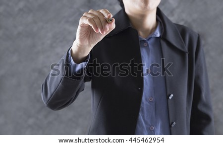gesture of businessman hand holding pen writing something for use as business concept - stock photo