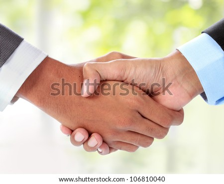 gesture of businessman's hand shaking - stock photo