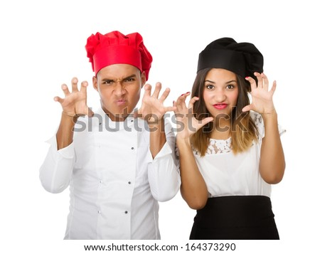gesture with hands for two aggressive cooks - stock photo