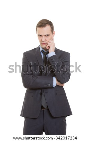 gestures distrust lies. body language. man in business suit isolated on white background. pulls the earlobe - stock photo
