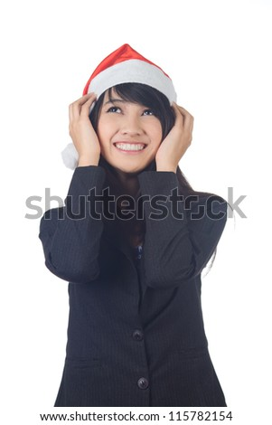 Gesturing Young asian  business  woman smiling with santa hat giving  you  a gift on white background