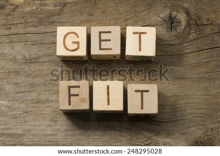 Get Fit text on a wooden background - stock photo