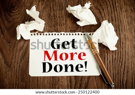 Get More Done! Business or Education Concept. Motivational message on a note paper - stock photo