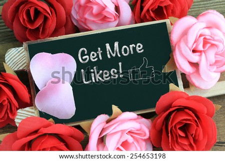 get more likes message written on chalkboard - stock photo