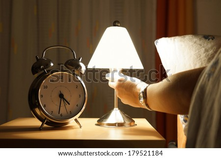 get out of bed in the middle of the night - stock photo