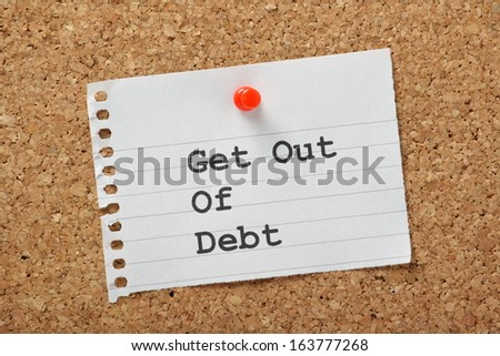 Get Out of Debt typed on a piece of lined paper pinned to a cork notice board. An aspiration for many in these times of austerity and rising costs. - stock photo