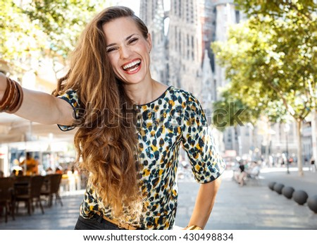 Get ready to exciting weekend at Barcelona. Smiling woman tourist taking selfie on street - stock photo