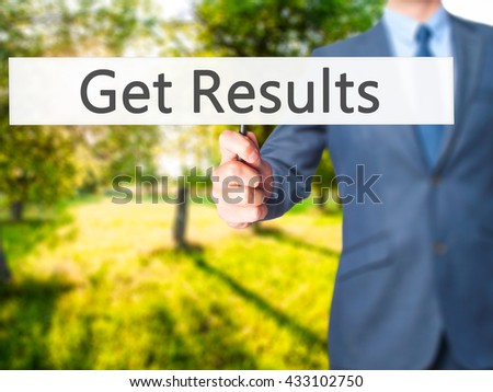 Get Results - Businessman hand holding sign. Business, technology, internet concept. Stock Photo - stock photo
