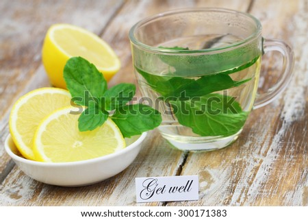 Get well card with glass of mint tea and lemon