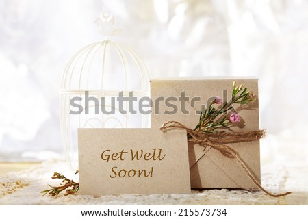 Get Well Soon hand crafted gift box and greeting card - stock photo