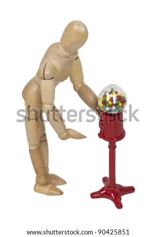 Getting a gumball from a vintage metal and glass gumball machine - path included - stock photo