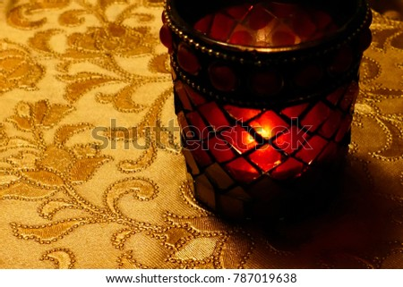 Getting into romantic mood with golden table cloth and candle light